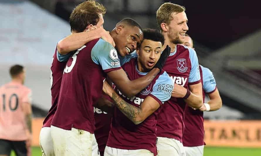 Issa Diop of West Ham celebrates with teammates Craig Dawson, Jesse Lingard and Tomas Soucek after scoring their team's second goal during the Premier League match between West Ham United and Sheffield United