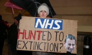 A woman protests outside the Department of Health in in London on 12 January