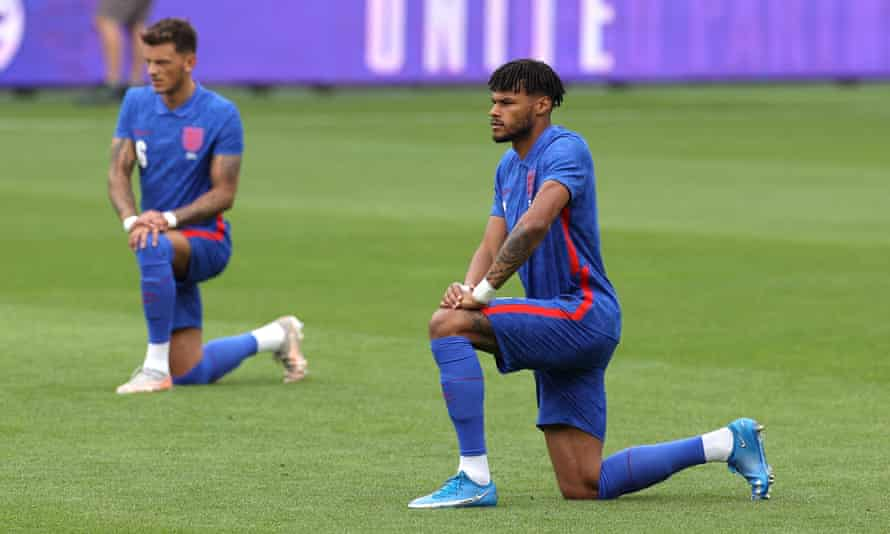 Tyrone Mings of England takes a knee.