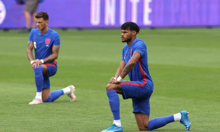 England's Tyrone Mings takes a knee before a friendly against Romania on Sunday.