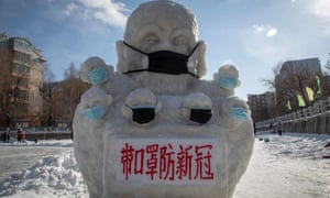 A snow statue in Jilin province with a face mask and a sign reading: 'Wear masks to prevent novel conoravirus.'