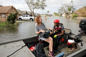 A local resident is evacuated by a rescue team after Hurricane Ida made landfall in Louisiana, in Laplace, Louisiana.