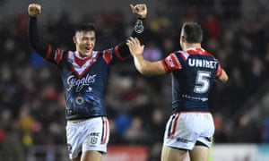 Joseph Manu and Brett Morriss celebrate victory for Sydney Roosters.