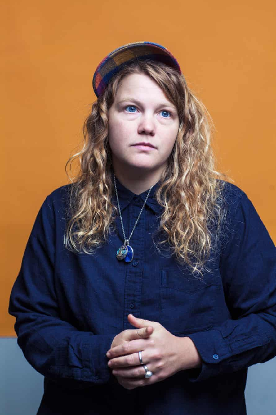 Kate Tempest looking serious clasping her hands together