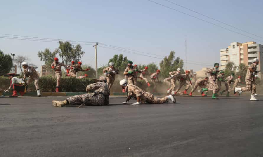 Soldiers react to the assault.
