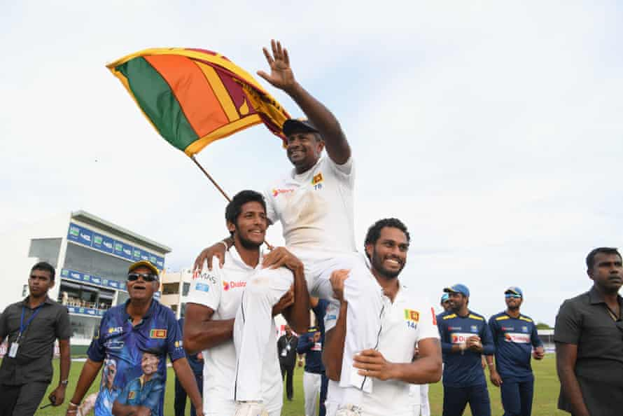 Rangana Herath is chairlifted around the pitch.