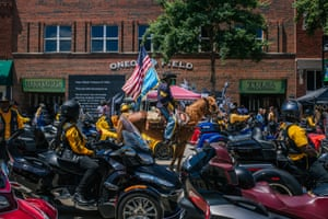 Members of the Buffalo Soldiers bike club participate in the centennial Black Wall St heritage parade in the Greenwood district of Tulsa, during the commemorations of the 100th anniversary of the Tulsa race massacre.