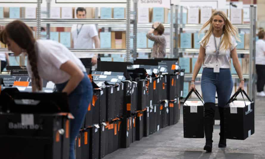 Ballot boxes arrive at a count centre in north London.