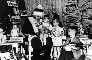 Baseball legend Babe Ruth plays Santa Claus during a 1947 Christmas party at the Hotel Astor in New York. The party was thrown by Sister Elizabeth Kenny for 65 young poliomyelitis victims including three-year-old Jimmy McCall, sat on Ruth's knee, and Jane Greenfield