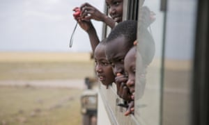 Children from Nairobi viewing wildlife in Amboseli National Park, on World Elephant Day, 12 August 2015.