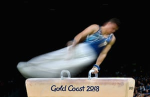 Cyprus' Ilias Georgiou competes on the parallel bars during the men's individual all-around final in artistic gymnastics.