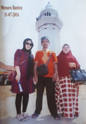 Siti Aisyah with her father Asria and mother Benah at Banten Central Park during the Eid holiday in July 2016, in one of their last photos together before she was arrested.
