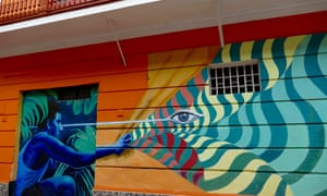 A mural painting with crouching figure in Callao, Lima