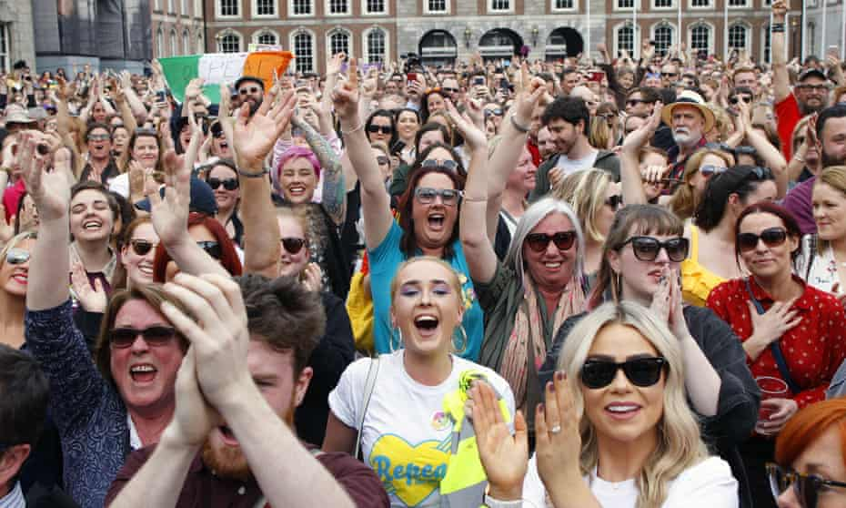 People from the 'Yes' campaign reacted as referendum results indicated voters had overwhelmingly backed repealing the 1983 constitutional ban on abortions.