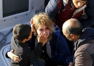 Izmir, Turkey: A boy wipes his mother's tears away