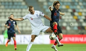 Eric Dier and Luka Modric compete for possession.