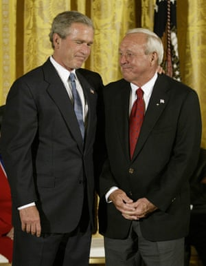23 June 2004. US President George W Bush jokes with Palmer before presenting the Presidential Medal of Freedom, the nation's highest civil award, at the White House.