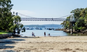 Parsley Bay in Sydney with its cove, pedestrian bridge, beach and lawned reserve.