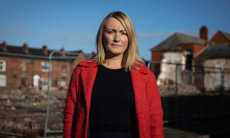 Jo Platt, MP for Leigh, in front of demolished housing