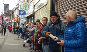 Volunteers hand books down a human chain in Southampton.