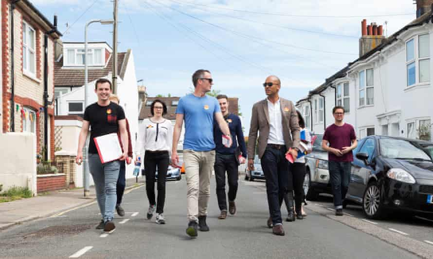 Chuka Umunna (front, right) visits local Labour candidate Peter Kyle (front, left) as he campaigns in Hove