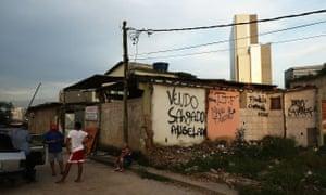 People gather in the mostly demolished Vila Autodromo favela community
