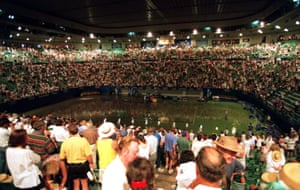 The crowd watch on at a soggy centre court after some flash floods in 1995.
