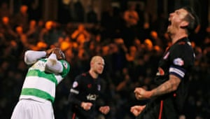 Yeovil's Francois Zoko is dejected after missing a penalty while Carlisle's Danny Grainger celebrates.