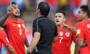 Chile trio Arturo Vidal, Alexis Sanchez and Gonzalo Jara argue with the referee Mauro Vigliano during Thursday's 3-0 defeat against Ecuador.