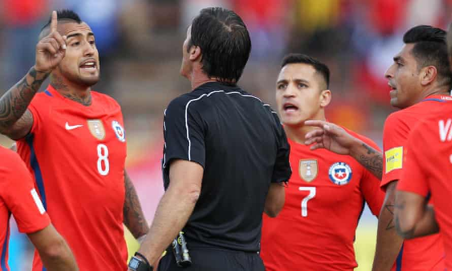 Chile trio Arturo Vidal, Alexis Sanchez and Gonzalo Jara argue with the referee Mauro Vigliano during Thursday's 3-0 defeat against Ecuador.