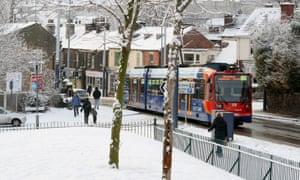 A tram makes its way through Hillsborough, Sheffield.