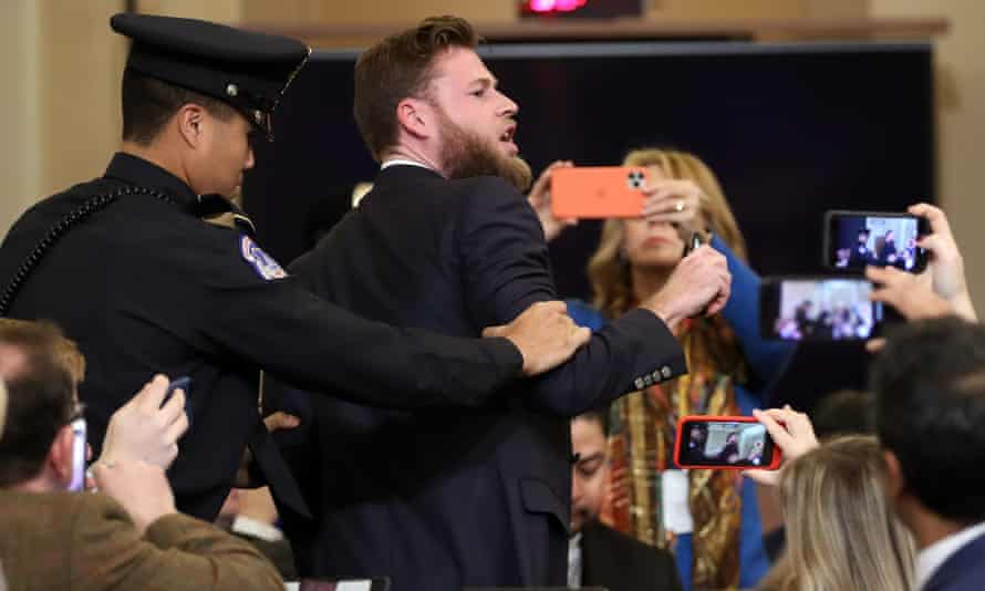 Owen Shroyer of Infowars is removed from the hearing.