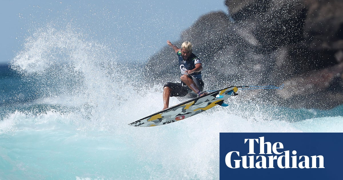 Surfer in denim shorts defies passport theft and hurricane to win on borrowed board