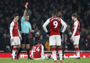 Referee Andre Marriner shows the red card.