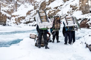 Porters carrying packs.