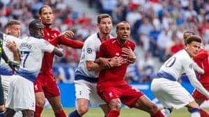 Jan Vertonghen of Tottenham Hotspur and Joel Matip of Liverpool battle for the ball.