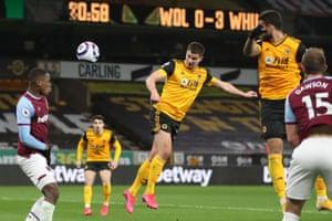 Wolverhampton Wanderers' Belgian midfielder Leander Dendoncker (C) scores.