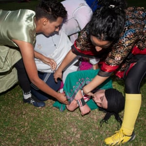 """A """"scrum"""" during the yearly demonstration match in traditional dresses for the AMAR team."""