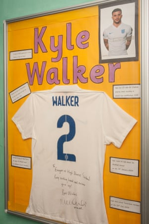 A signed England shirt from Kyle Walker adorns a wall at High Storrs school's gym.