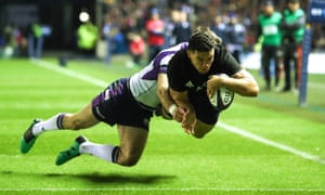 New Zealand's Codie Taylor dives over the line for a try in his side's hard-fought win over Scotland at Murrayfield.