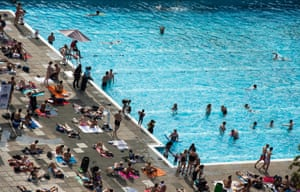 Sunbathers gather at Brockwell Lido in south-east London