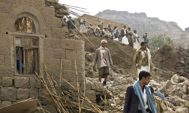 Yemenis stand amid the rubble of houses destroyed by Saudi-led air strikes in a village near Sana'a. Photograph: Hani Mohammed/AP