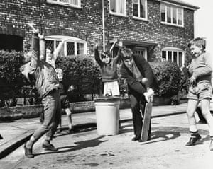 George enjoys an impromptu game of cricket with some of his neighbours' children in Manchester in 1968