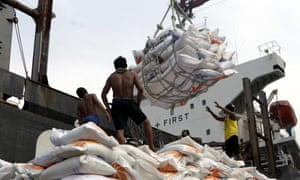 Indonesian workers load rice on a truck at Tanjung Priok Port in Jakarta, Indonesia, on 14 November. Indonesia will import about 1.5m tonnes of rice from Vietnam due to the impact of El Niño.