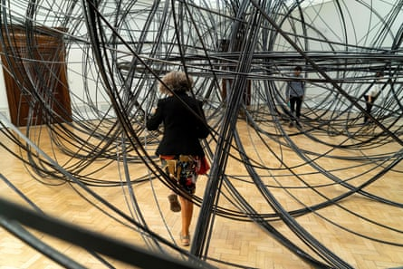 A visitor walks through Clearing VII by Antony Gormley at the Royal Academy.