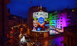 BBC live election coverage is projected onto the side of a building in Central London