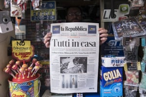A news vendor holds up a copy of La Repubblica Italian Newspaper as Italy clamps down on public events and travel to halt the spread of the coronavirus on March 10, 2020 in Turin, Italy.