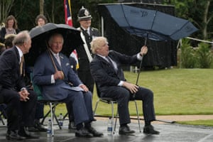 Alrewas, UKThe Prince of Wales looks on as Prime Minister Boris Johnson opens an umbrella at the unveiling of the UK Police Memorial at the National Memorial Arboretum. The £4.5 million memorial commemorates all personnel who have lost their lives since the 1749 formation of the Bow Street Runners
