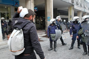 Farmers protest in central Athensepa05155858 An injured farmer puts ice cubes on his head after clashes with riot policemen during a protest outside the Agriculture Ministry in Athens, Greece, 12 February 2016. Farmers from all over Greece organise a massive protest in central Athens requesting that the government withdraws its proposed social security and pension reform plan. Protesters are expected to meet in Athens and walk towards the Parliament on Syntagma square, where they will set up tents to house farmers who will remain there for the entire weekend. EPA/PANTELIS SAITAS