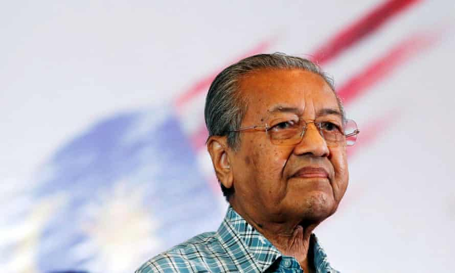 Malaysia's King asked Mahathir Mohamad to stay on as interim leader while other parties scramble to form a govenrment.